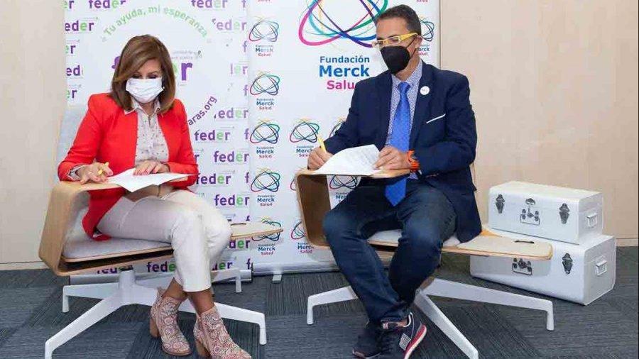 Firma de acuerdo entre Merck y FEDER.